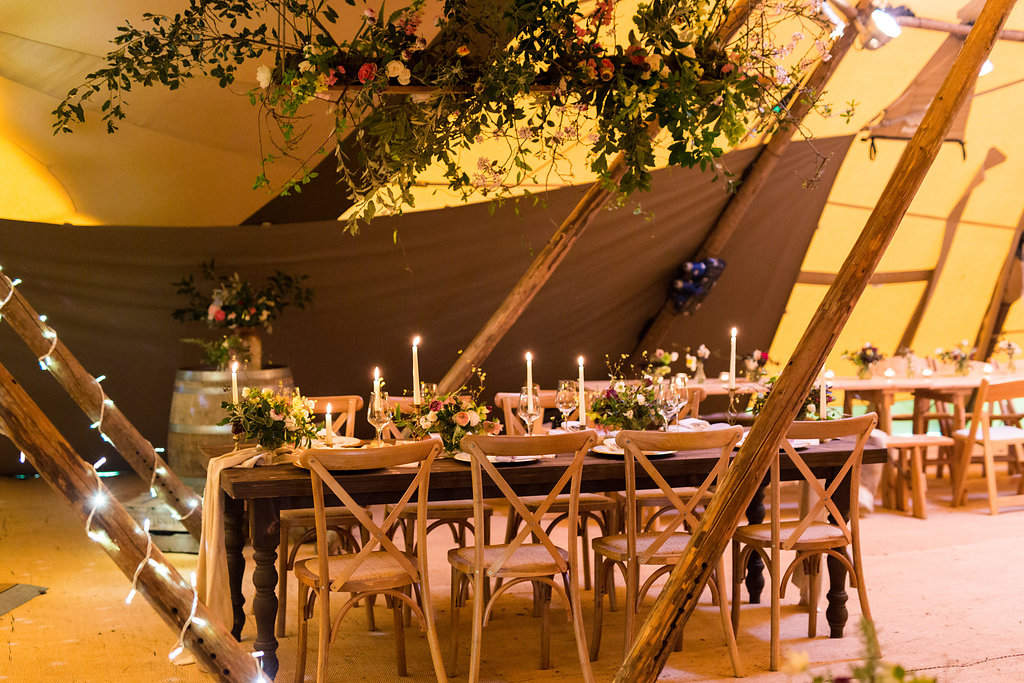 Top Table elegance with Farmhouse Tables, Cross Back Chairs and flowers by Forage and Blossom