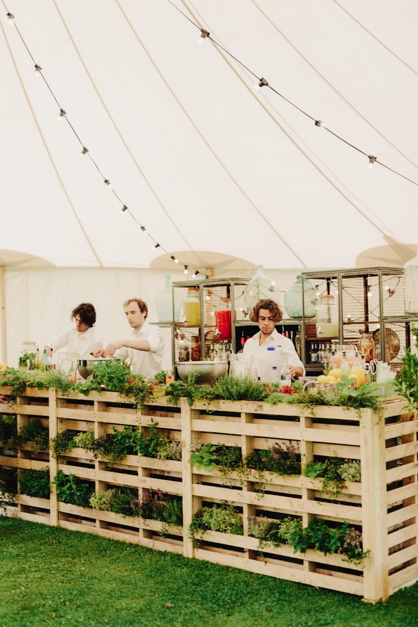 Bar overflowing with fresh herbs brings the outside in PapaKåta Sperry Tent Wedding at West Dean Gardens, Chichester, West Sussex, by Cinzia Bruschini