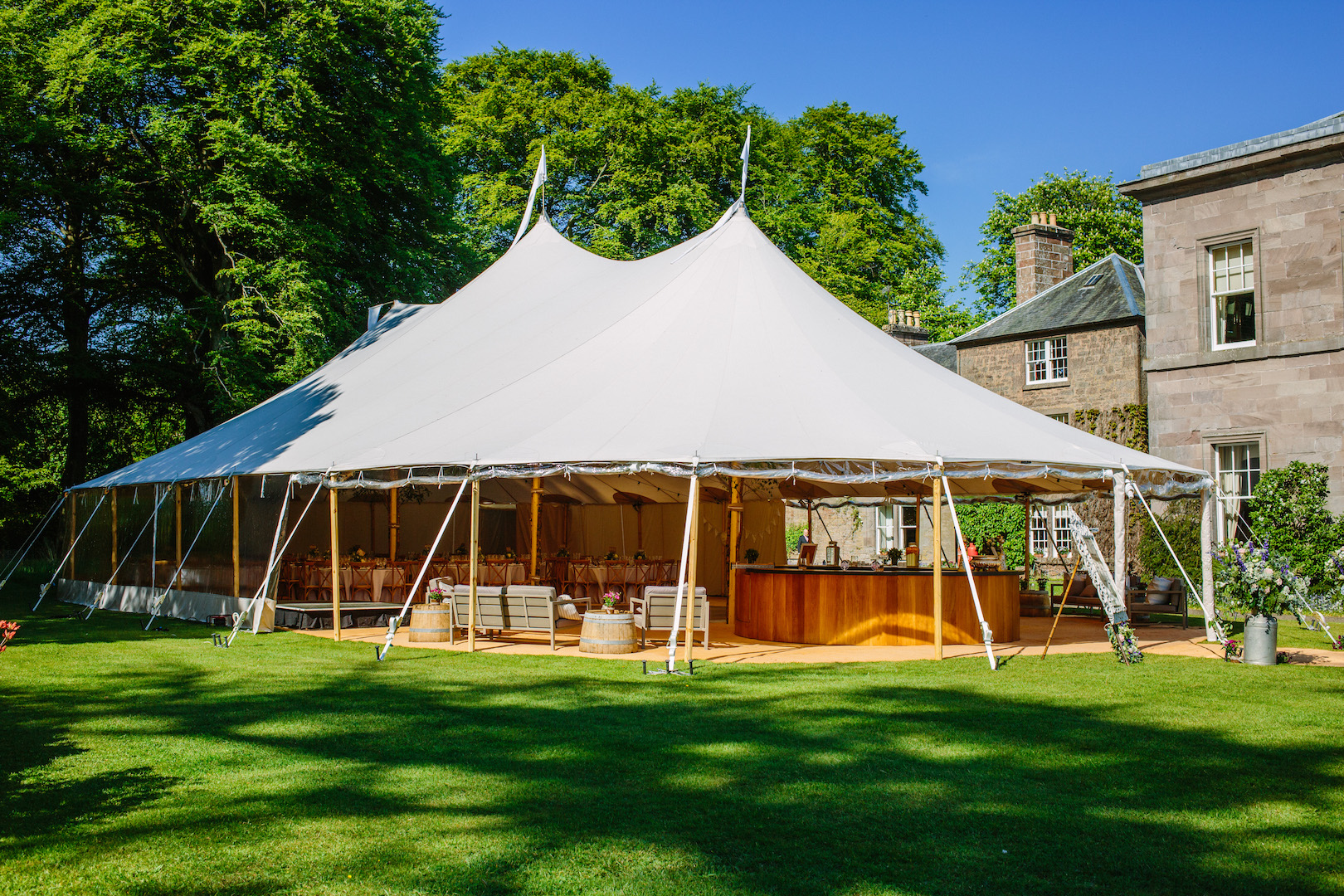 Alice & Alex's PapaKåta Sperry Wedding at Dunsinnan House, Scotland- Sperry Tent Exterior by Eilidh Sutherland Photography