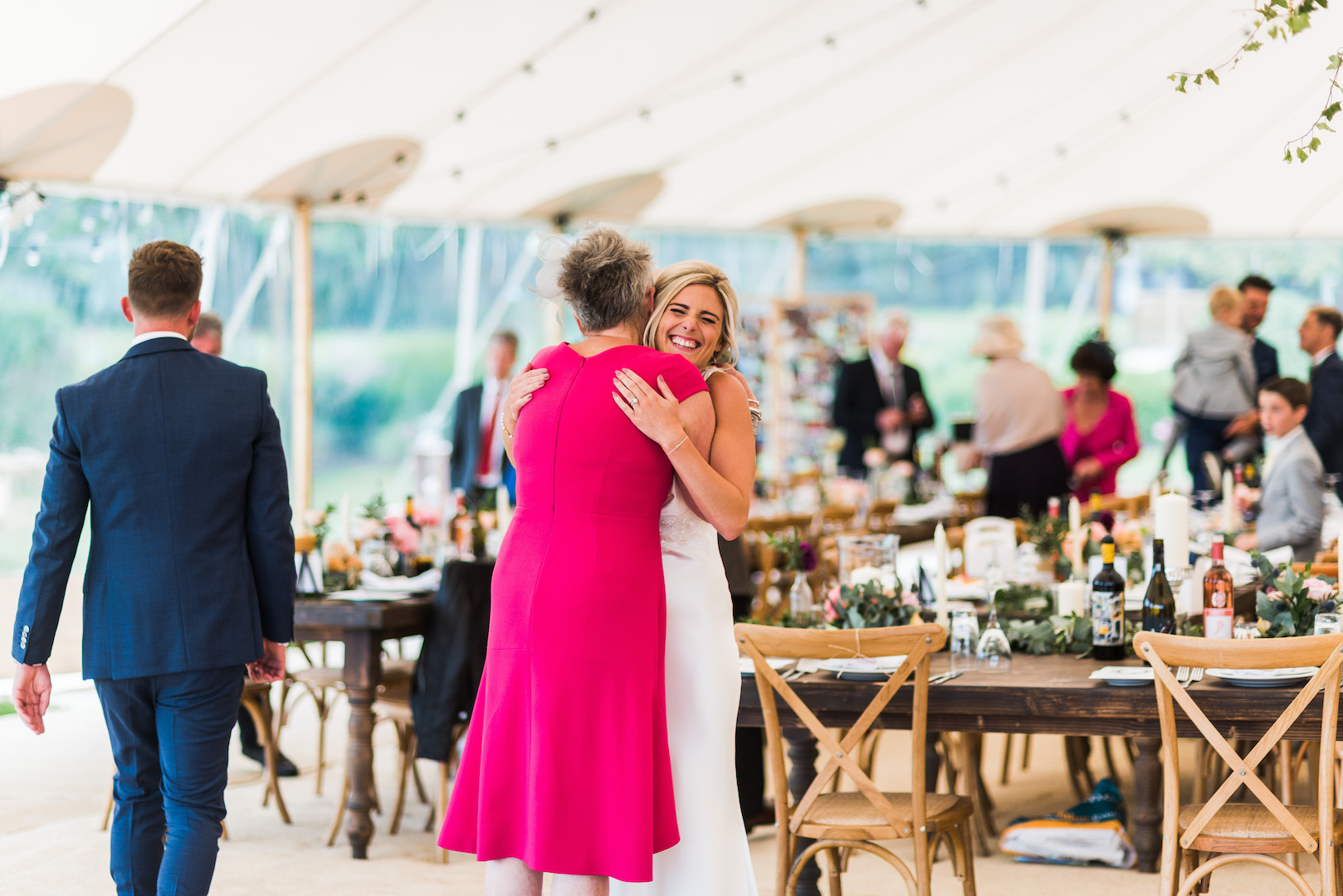 Sarah and Joe's PapaKata Sperry Wedding: Bride welcoming guests