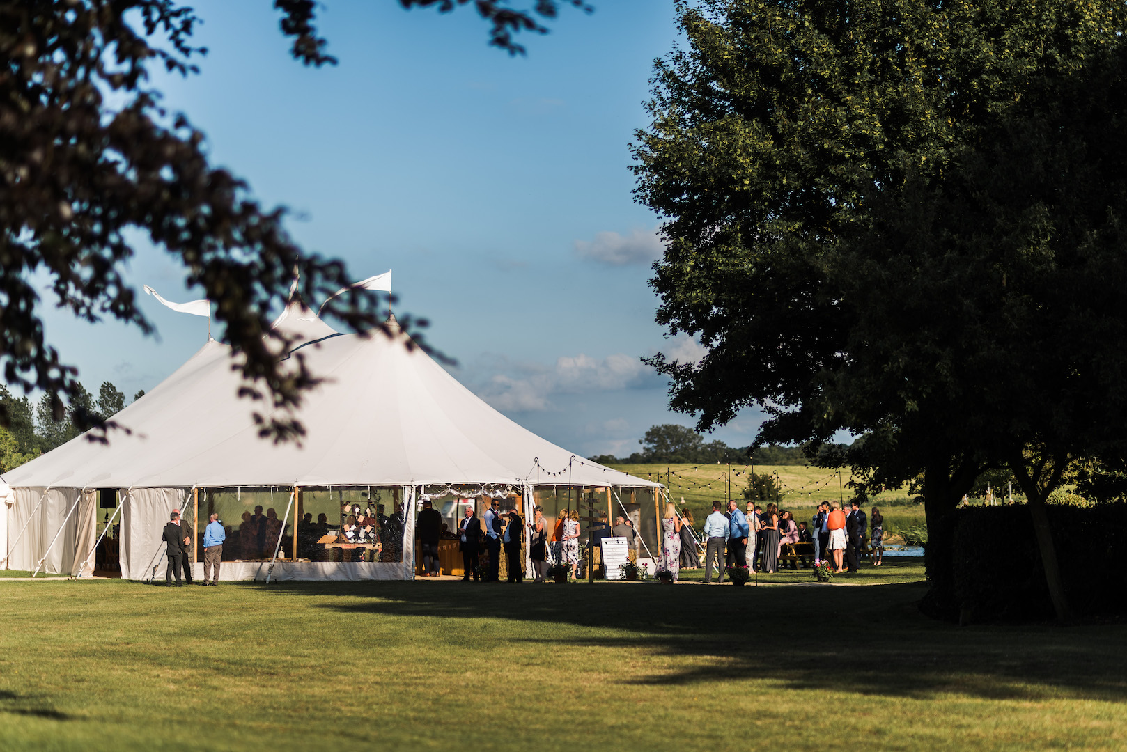 Sarah and Joe's PapaKata Sperry Wedding: Sperry tent exterior by Paul Mockford Photography