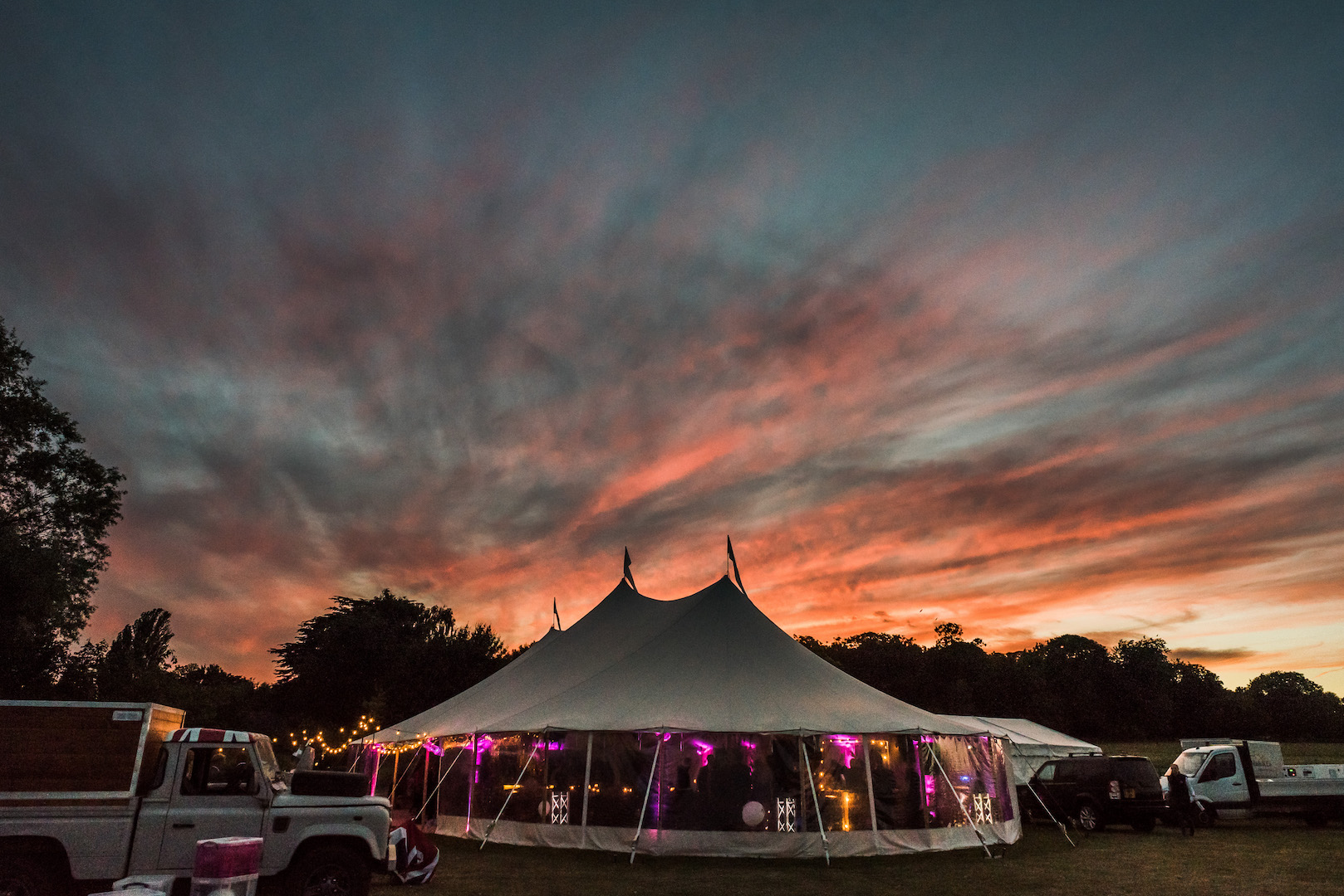 Sarah and Joe's PapaKata Sperry Wedding: Sperry tent night exterior by Paul Mockford Photography