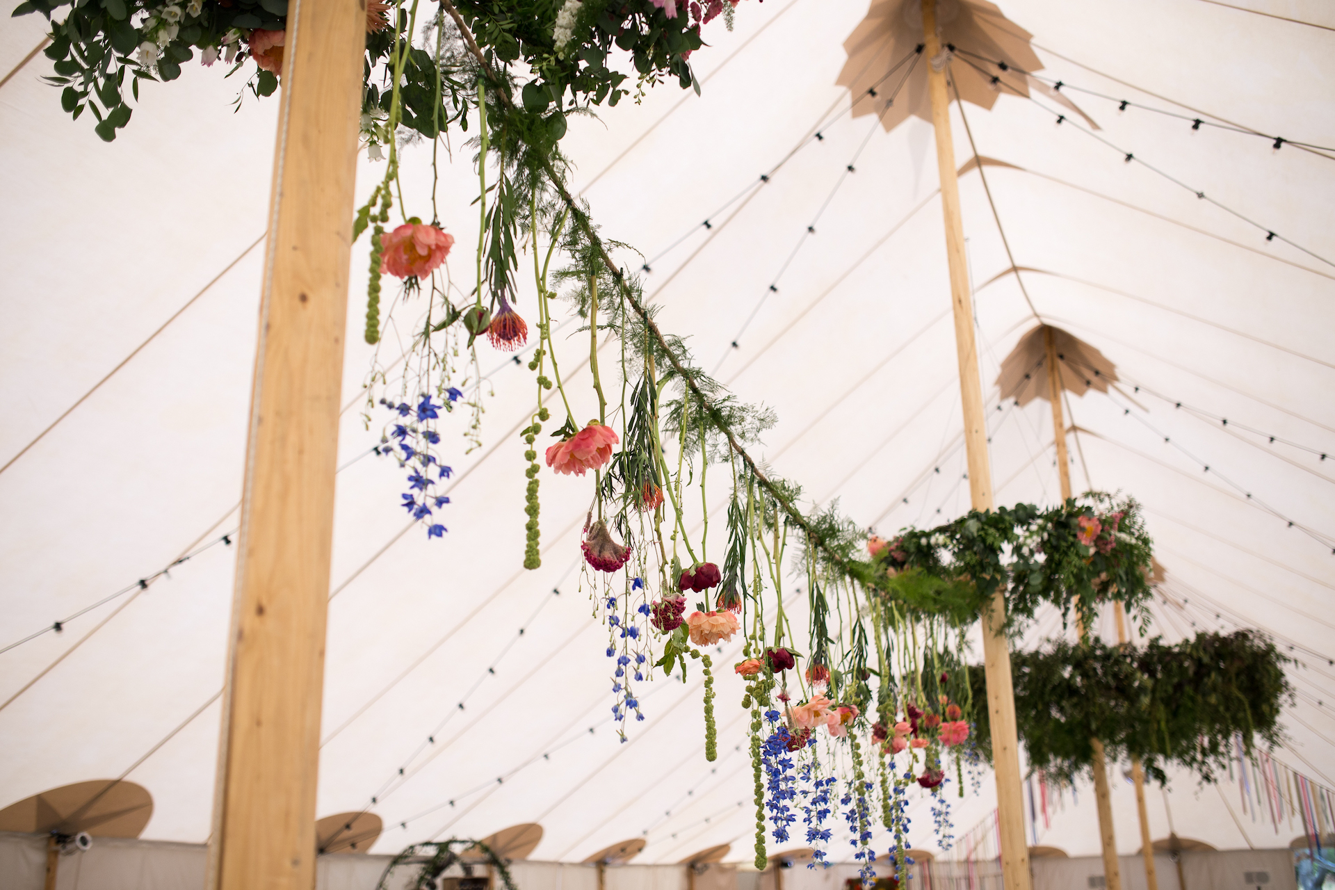 PapaKåta Sperry Tent Wedding at Ella & George's family home in Sussex- Hanging Floral Elements
