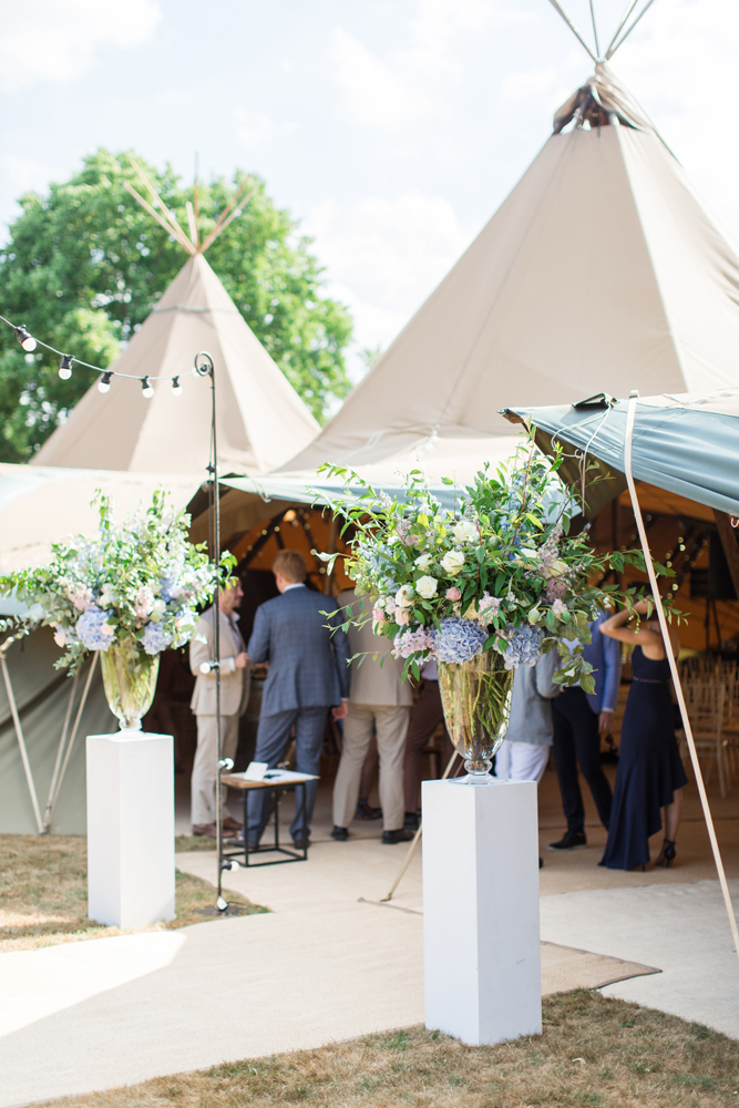 PapaKåta Teepee Wedding in Buckinghamshire Planned by Charlotte Elise Weddings and Events captured by Cecelina Photography- Entrance Floral Designs by Early Hours
