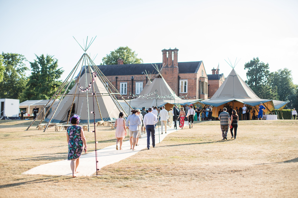 PapaKåta Teepee Wedding in Buckinghamshire Planned by Charlotte Elise Weddings and Events captured by Cecelina Photography- Naked Teepee with Festoon Walkway