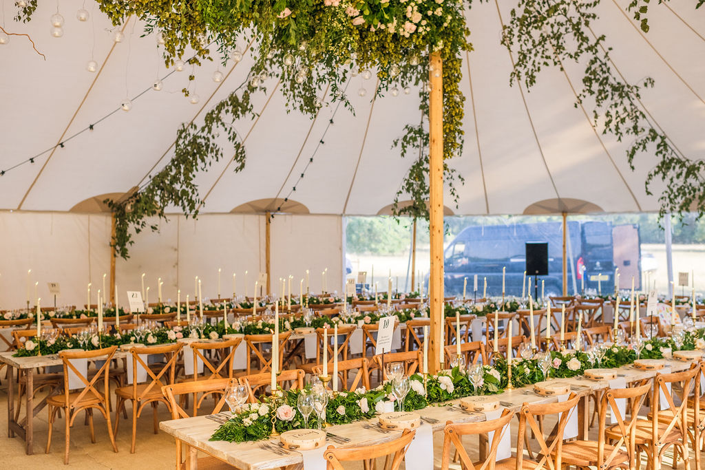 PapaKåta Couple Lucy & Martin's Sperry Tent Wedding at Norton Hall captured by Dan Morris Photography - Sperry Tent Interior- Flowers by Fiona Perry Floral Designs