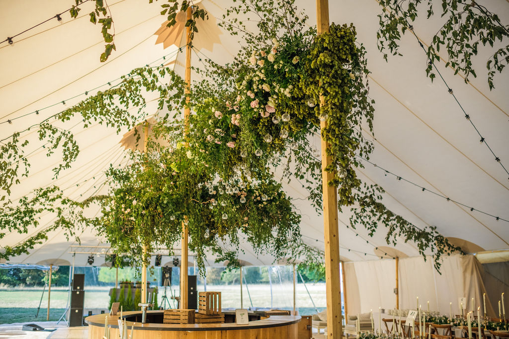 PapaKåta Couple Lucy & Martin's Sperry Tent Wedding at Norton Hall captured by Dan Morris Photography - Floral Installation by Fiona Perry Flowers