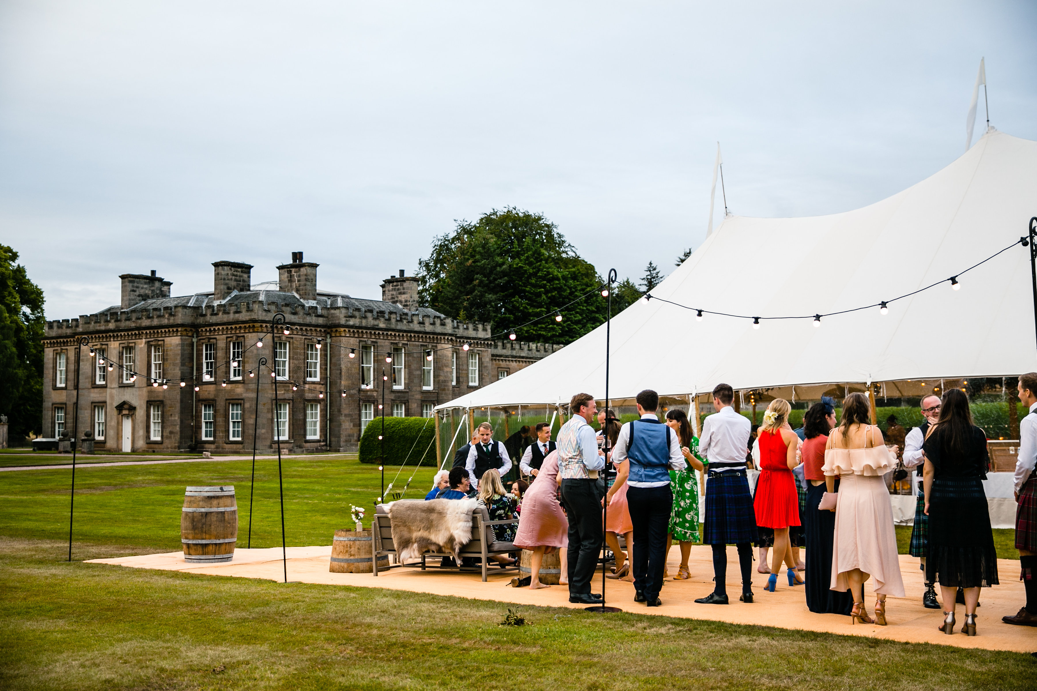 PapaKåta couple Lucy & Tom's Sperry Wedding at Gordon Castle Scotland captured by Helen Abraham Photography- Sperry Tent Exterior