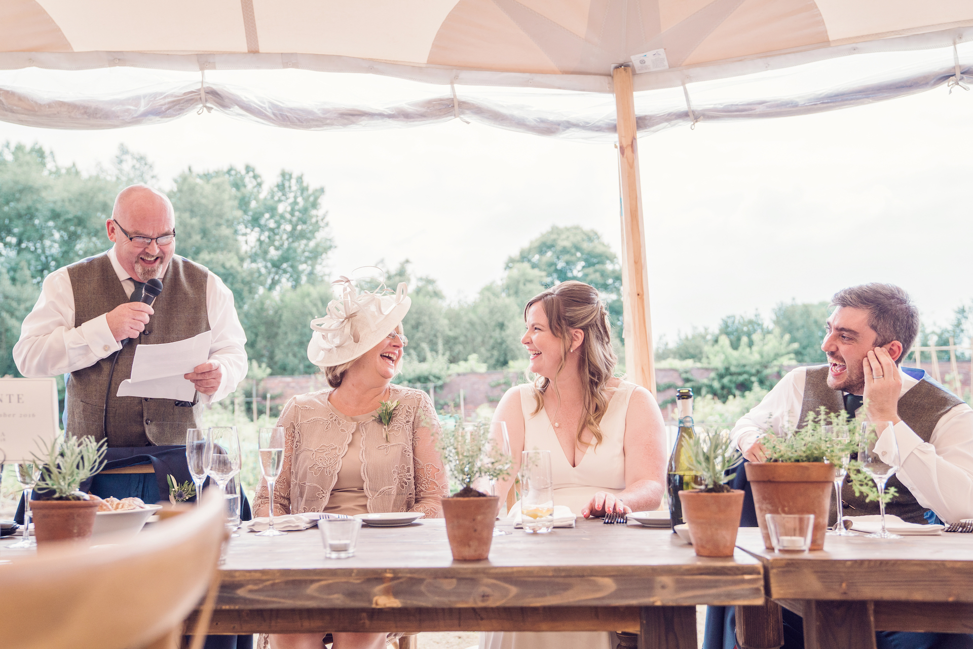 PapaKåta couple Louise & Alex's Sperry Wedding at Elford Hall Garden, Staffordshire captured by Jessica Raphael Photography- Top table wedding party