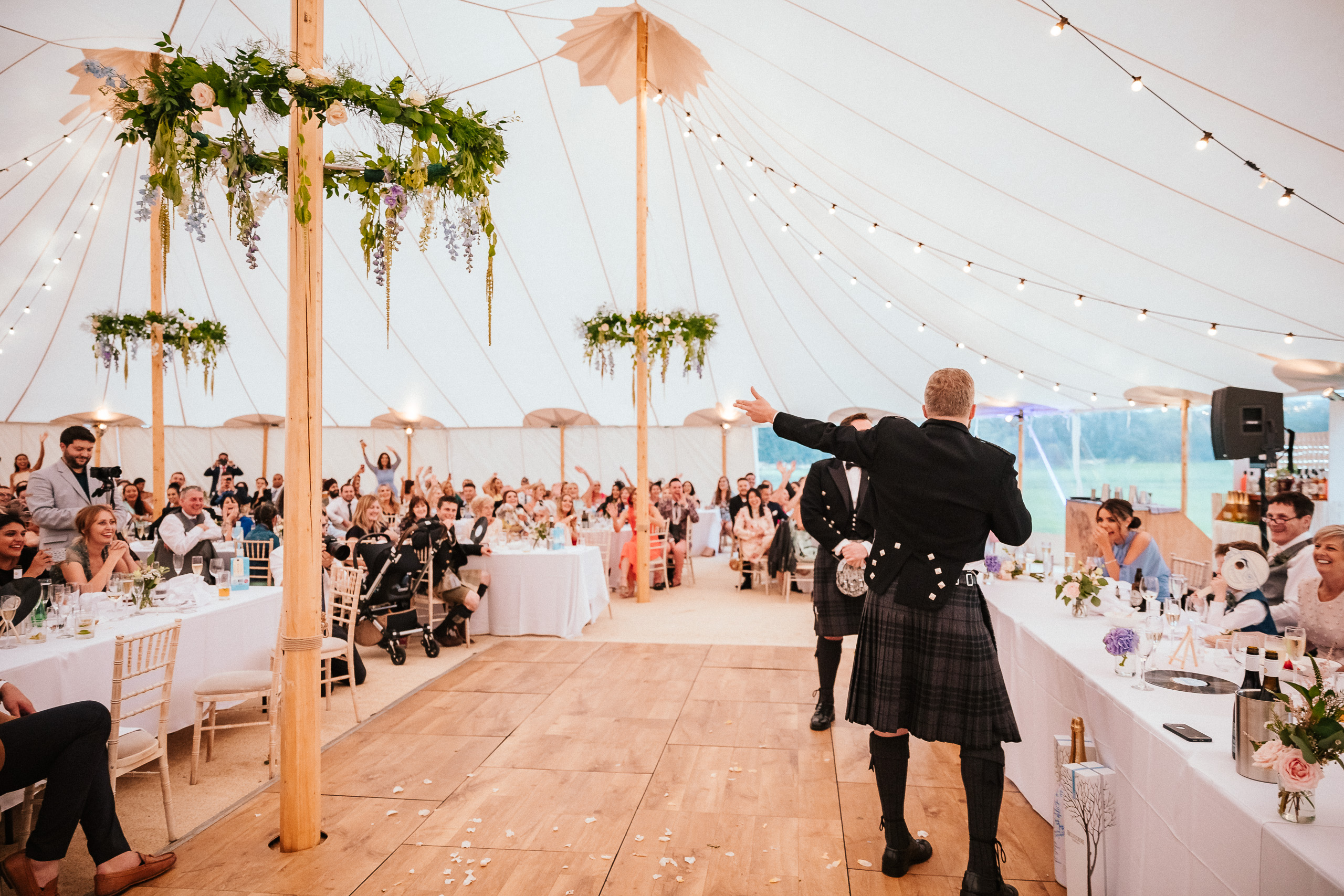 PapaKåta couple April & Martin's Sperry wedding at Arniston House, Scotland captured by Laurence Howe Photography- Sperry Tent interior. Floral Hoops by Save The Date Collective