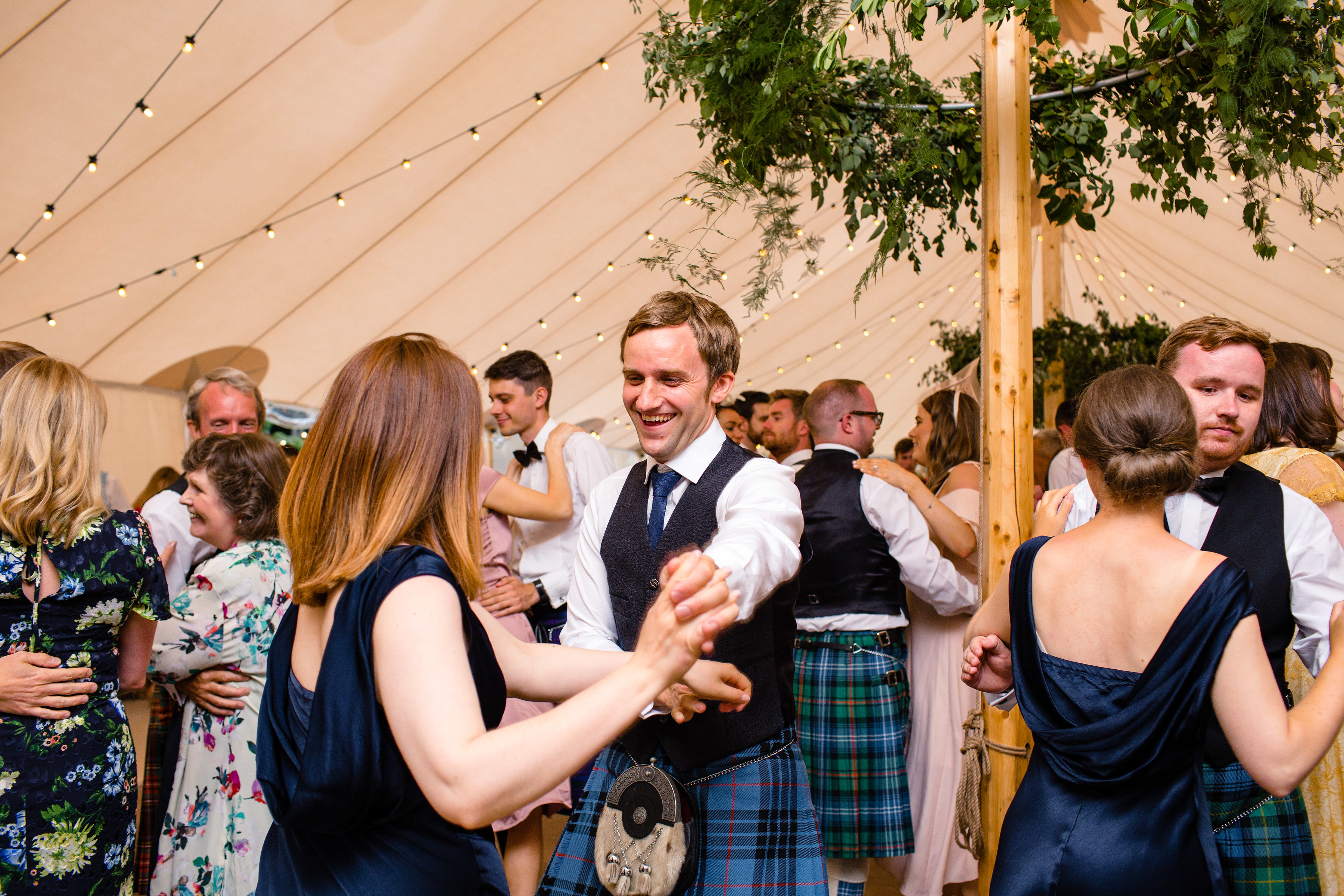 PapaKåta couple Lucy & Tom's Sperry Wedding at Gordon Castle Scotland captured by Helen Abraham Photography- Ceilidh dance