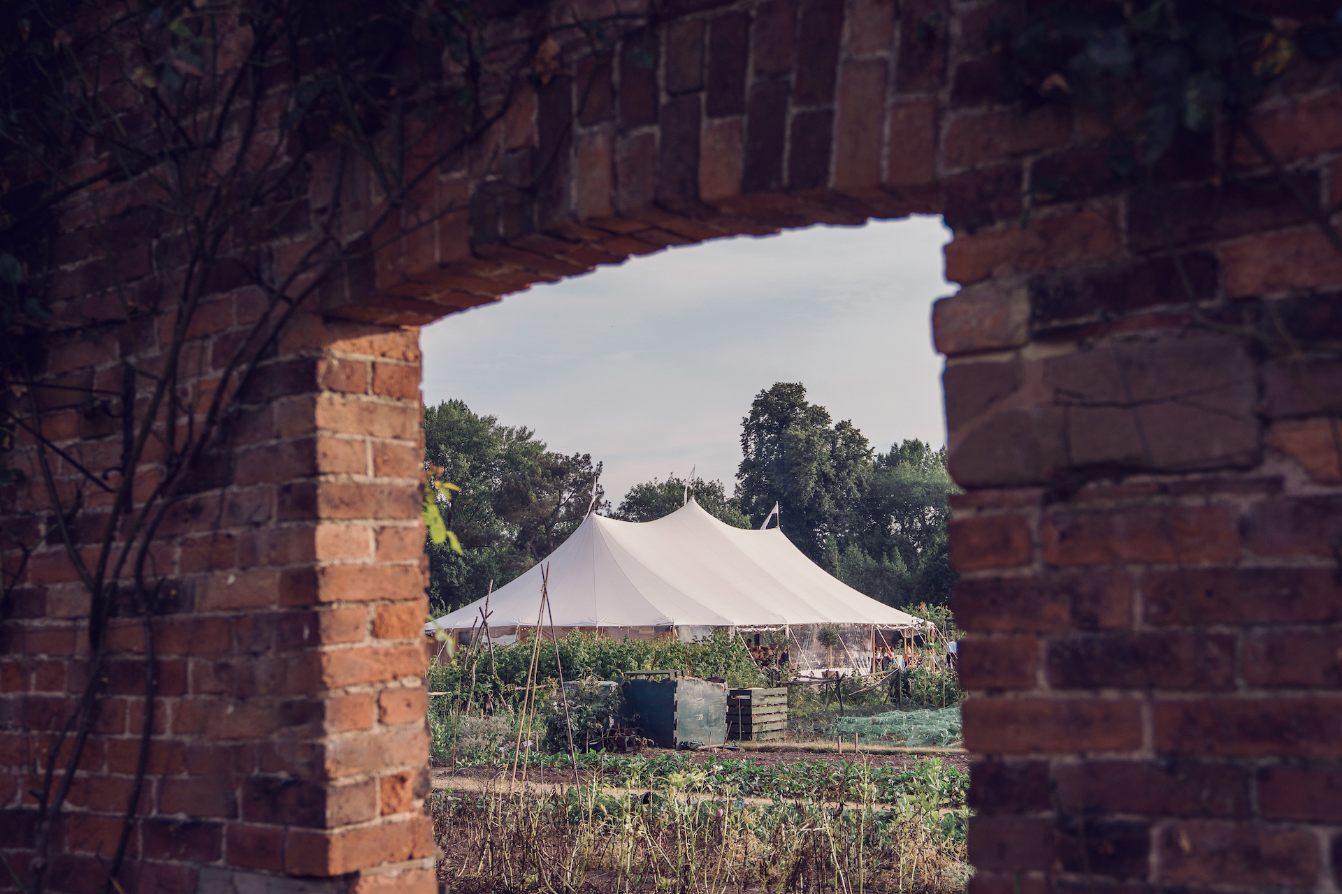PapaKåta couple Louise & Alex's Sperry Wedding at Elford Hall Garden, Staffordshire captured by Jessica Raphael Photography- Sperry Tent Walled Garden Wedding