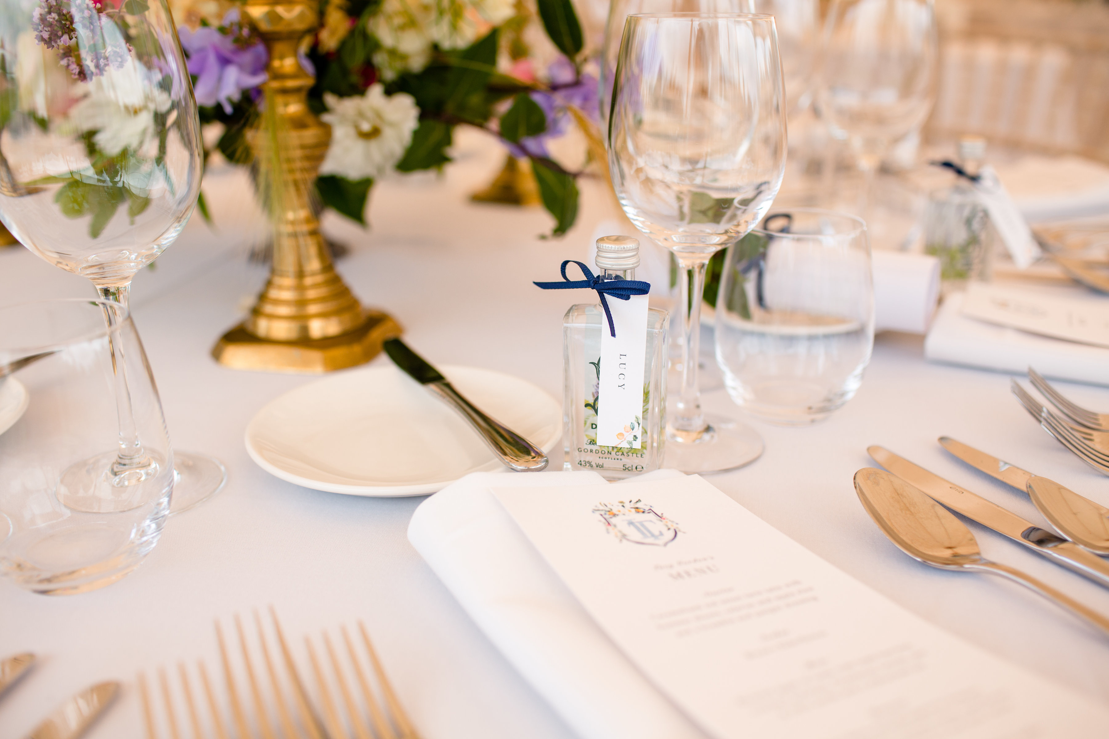 PapaKåta couple Lucy & Tom's Sperry Wedding at Gordon Castle Scotland captured by Helen Abraham Photography- mini gin bottle wedding favours