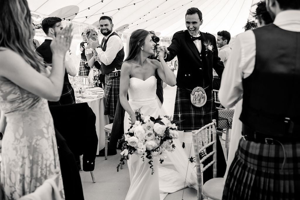 PapaKåta couple Lucy & Tom's Sperry Wedding at Gordon Castle Scotland captured by Helen Abraham Photography- Making an entrance