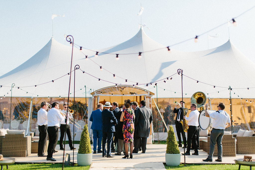 PapaKåta couple Georgina & Steve Sperry Tent Wedding in Barnby Dun, Doncaster captured by Melissa Beattie- Festoon Terrace with brass band by Warble Entertainment