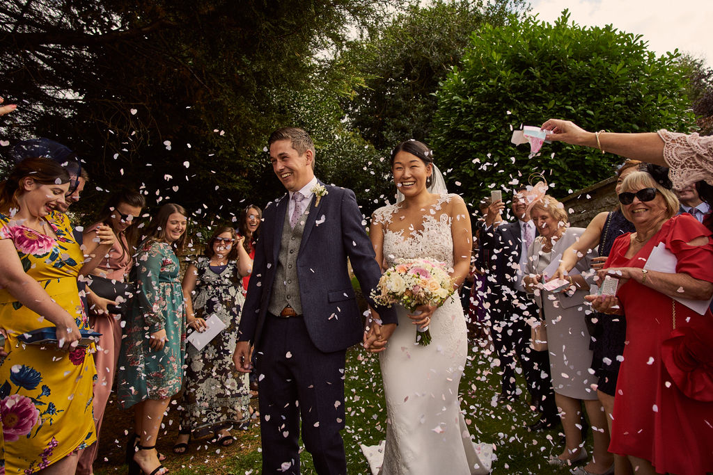 PapaKåta couple Lucy & Chris' Teepee Wedding in Terrington North Yorkshire captured by Chris Morse Photography- Confetti throw