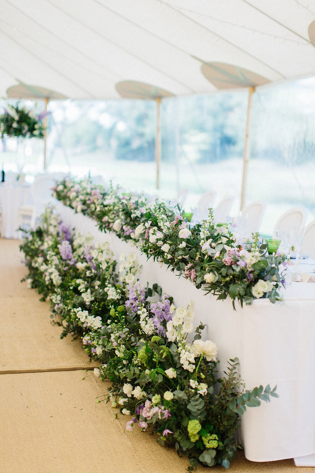 PapaKåta couple Georgina & Steve Sperry Tent Wedding in Barnby Dun, Doncaster captured by Melissa Beattie- Top table florals reused from the ceremony by Lucy MacNicoll