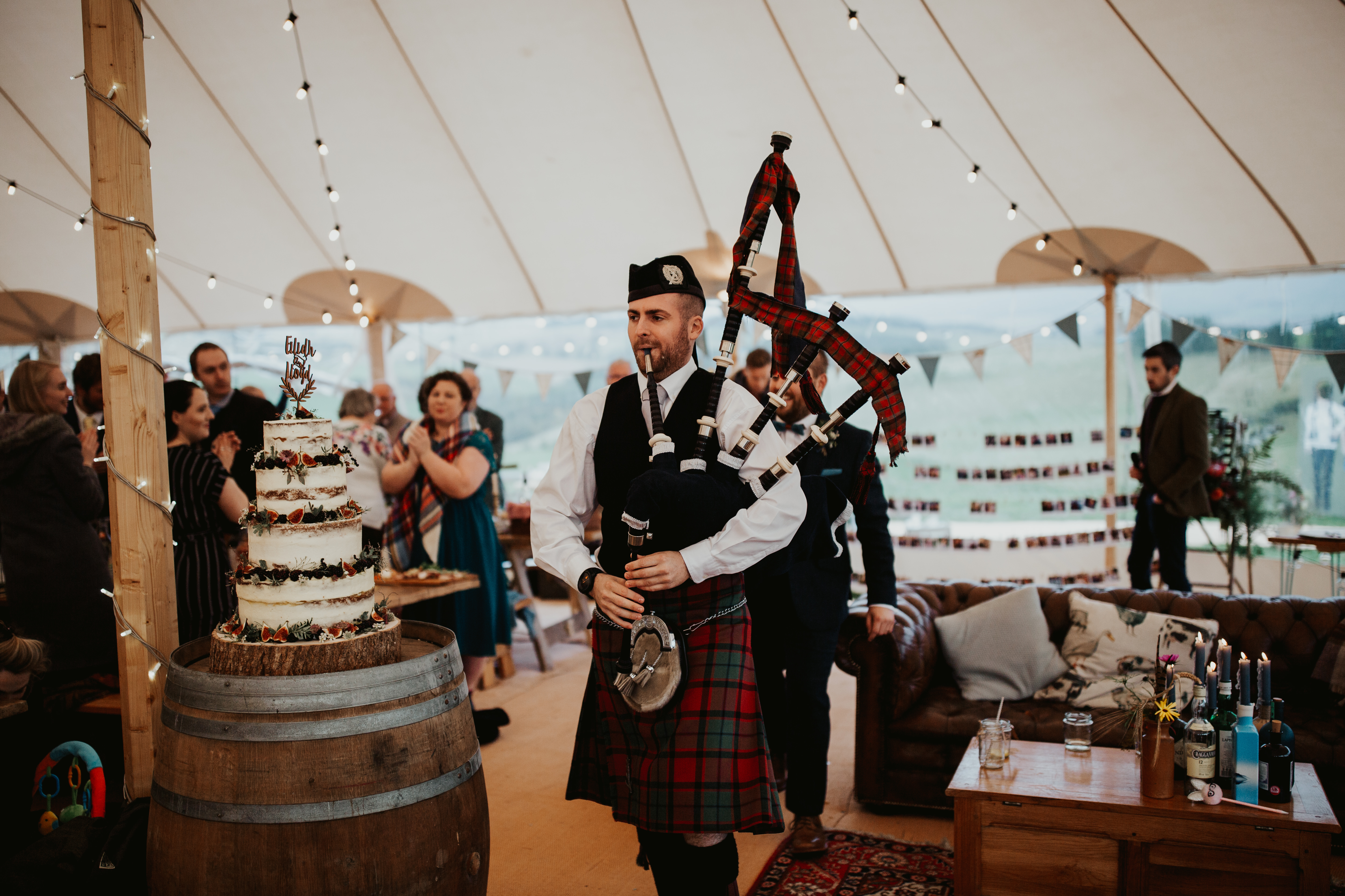 PapaKåta couple Eilidh & Lloyd's Sperry Wedding in Glenfarg, Perthshire captured by Colin Ross Photography- Bagpipe entrance