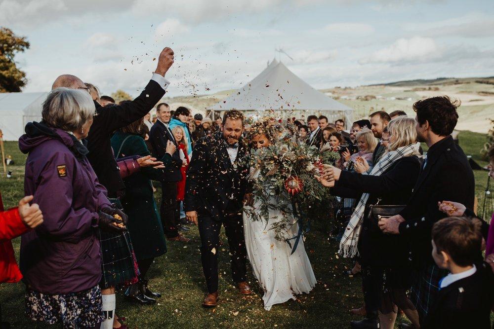 PapaKåta couple Eilidh & Lloyd's Sperry Wedding in Glenfarg, Perthshire captured by Colin Ross Photography- Confetti throw