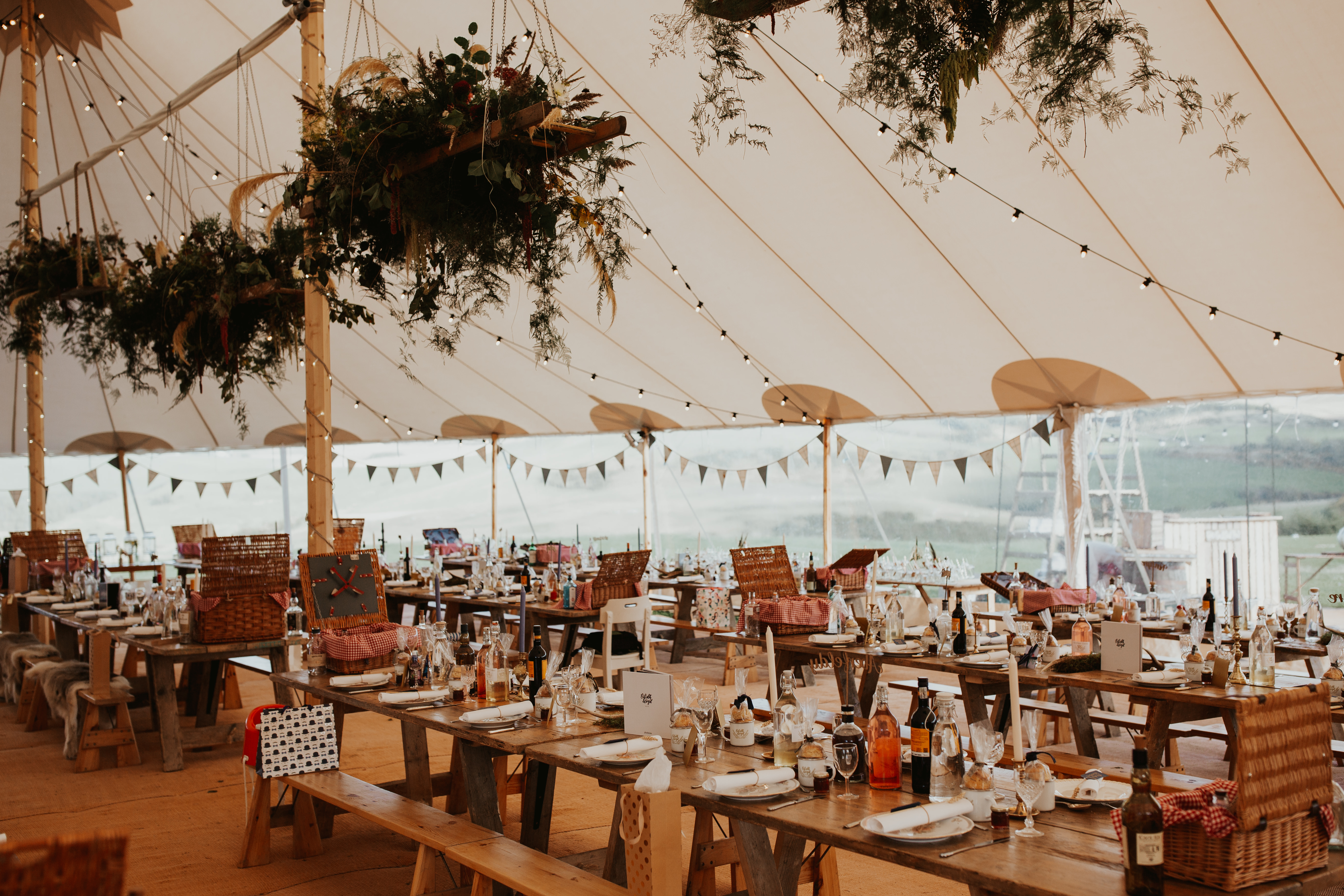 PapaKåta couple Eilidh & Lloyd's Sperry Wedding in Glenfarg, Perthshire captured by Colin Ross Photography- Sperry Tent interior with picnic style wedding breakfast