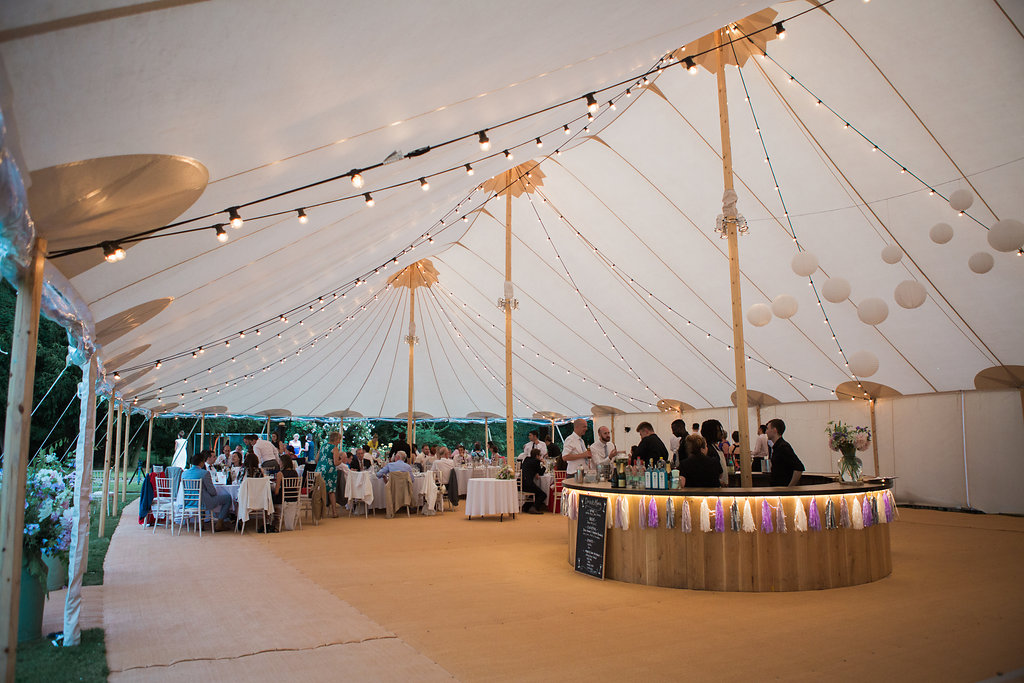 Georgie & Ben's PapaKåta Sperry Tent wedding at Newington House captured by Lucy Davenport: Sperry Tent interior with Festoon Drape