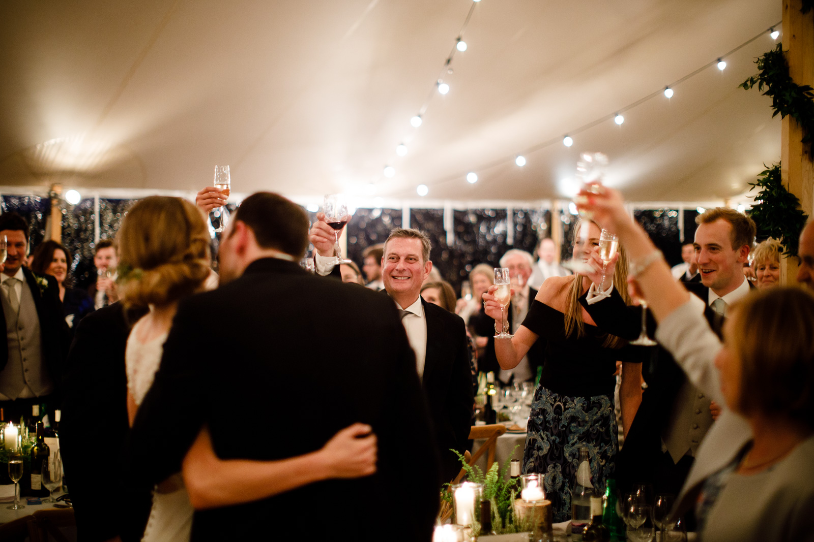 Emily & Ed's PapaKåta Sperry Tent wedding at Buckhurst Park captured by Tony Hart Photography: Toast To The Couple