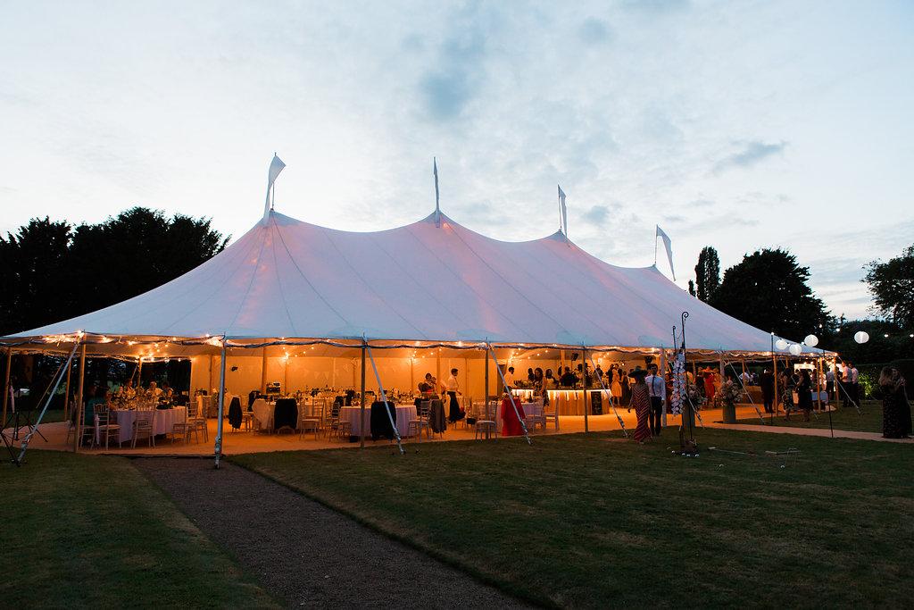 Georgie & Ben's PapaKåta Sperry Tent wedding at Newington House captured by Lucy Davenport: Sperry Tent exterior at night!