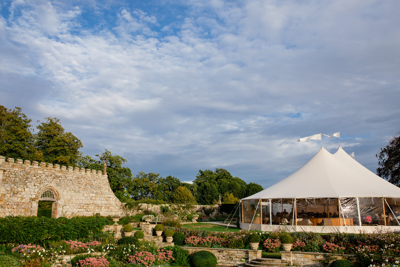 Emily & Ed's PapaKåta Sperry Tent wedding at Buckhurst Park captured by Tony Hart Photography: Sperry Tent exterior in walled garden