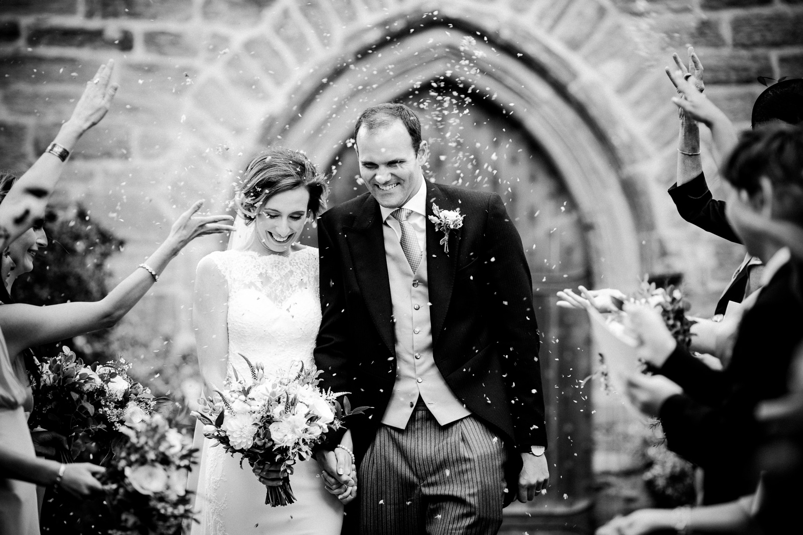 Emily & Ed's PapaKåta Sperry Tent wedding at Buckhurst Park captured by Tony Hart Photography: Confetti throw