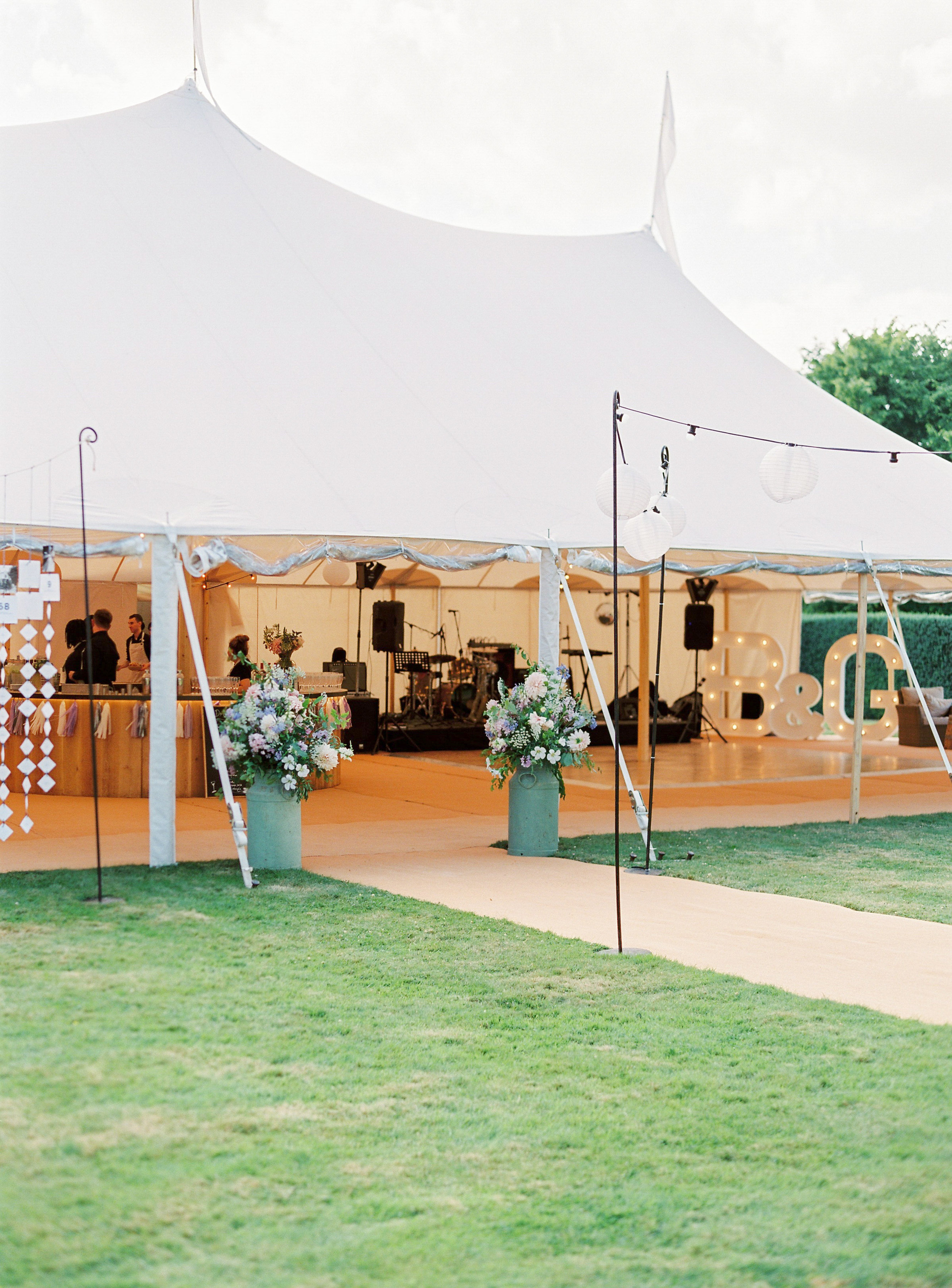 Georgie & Ben's PapaKåta Sperry Tent wedding at Newington House captured by Lucy Davenport: Festoon Walkway