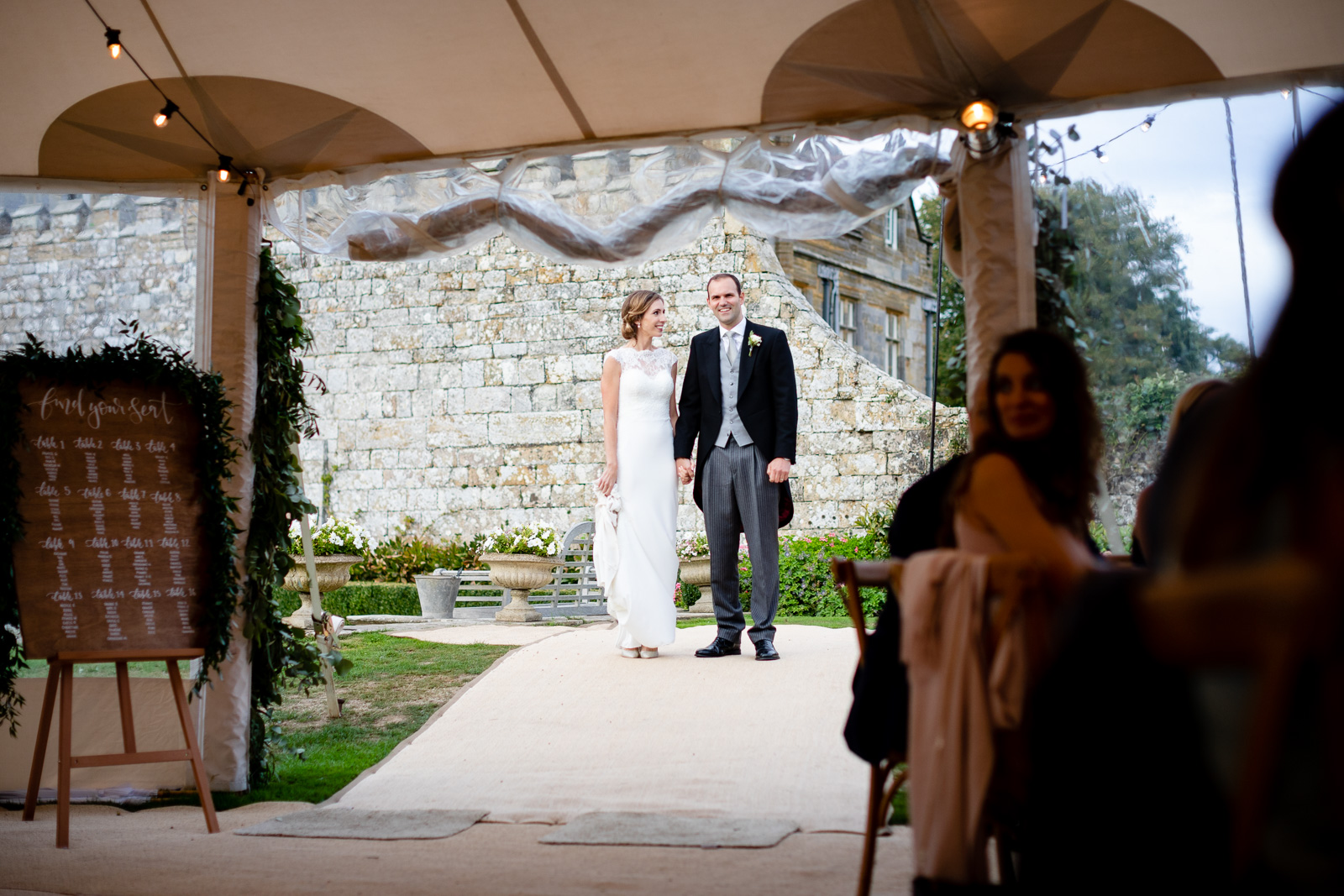 Emily & Ed's PapaKåta Sperry Tent wedding at Buckhurst Park captured by Tony Hart Photography: Making an entrance