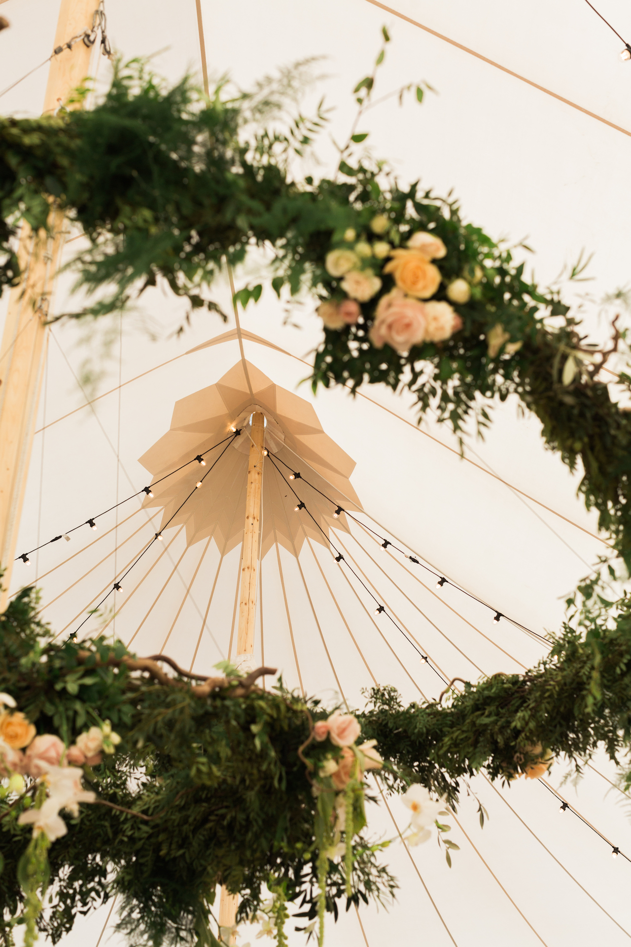 PapaKåta Spring Open Weekend Sperry Tent captured by Lucy Davenport Photography: Two Tier Floral Hoop by Leafy Couture