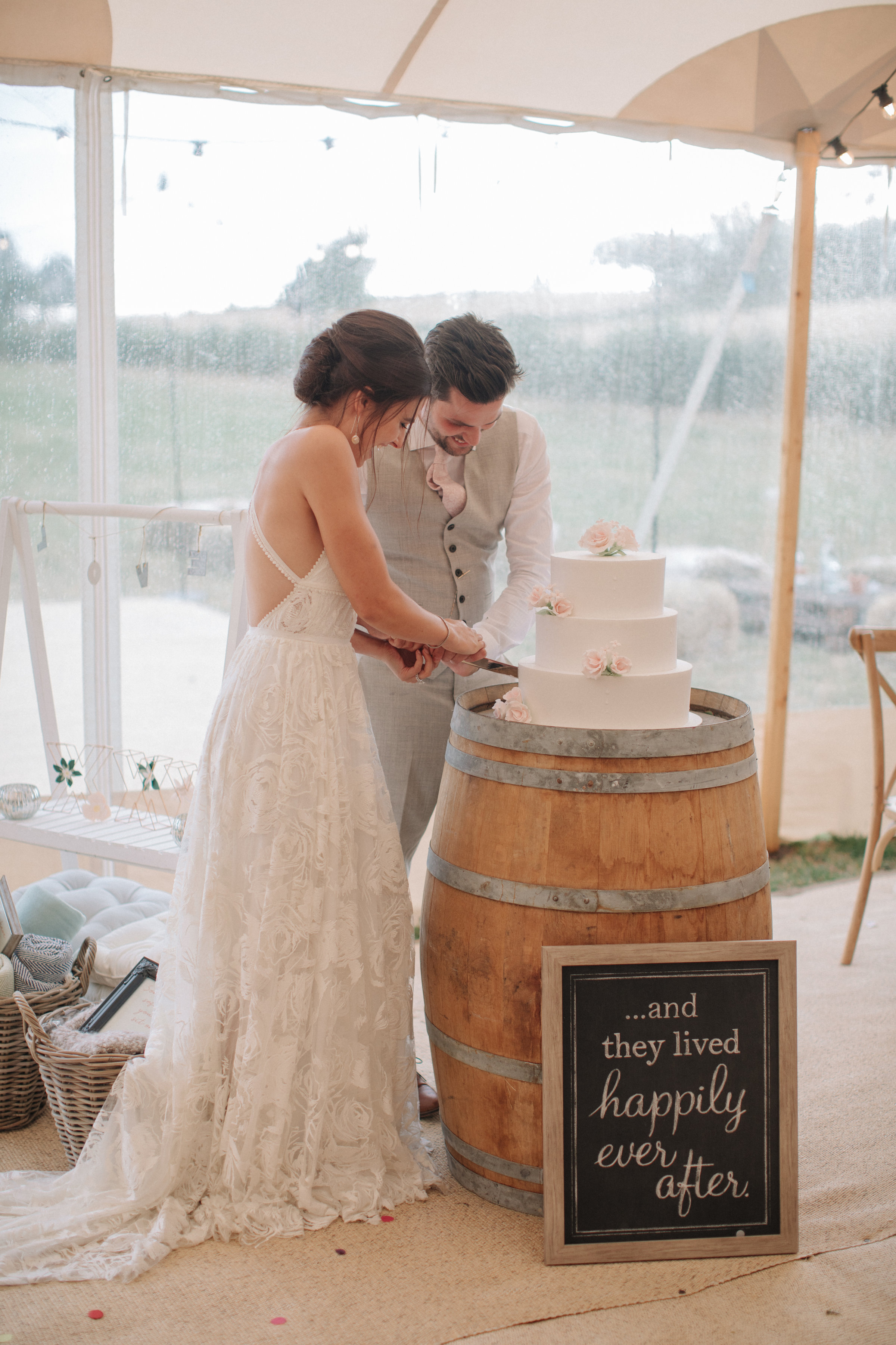 Steph & Ed's PapaKåta Sperry Tent wedding at home in Nottingham captured by M & J Photography: Cutting the Cake