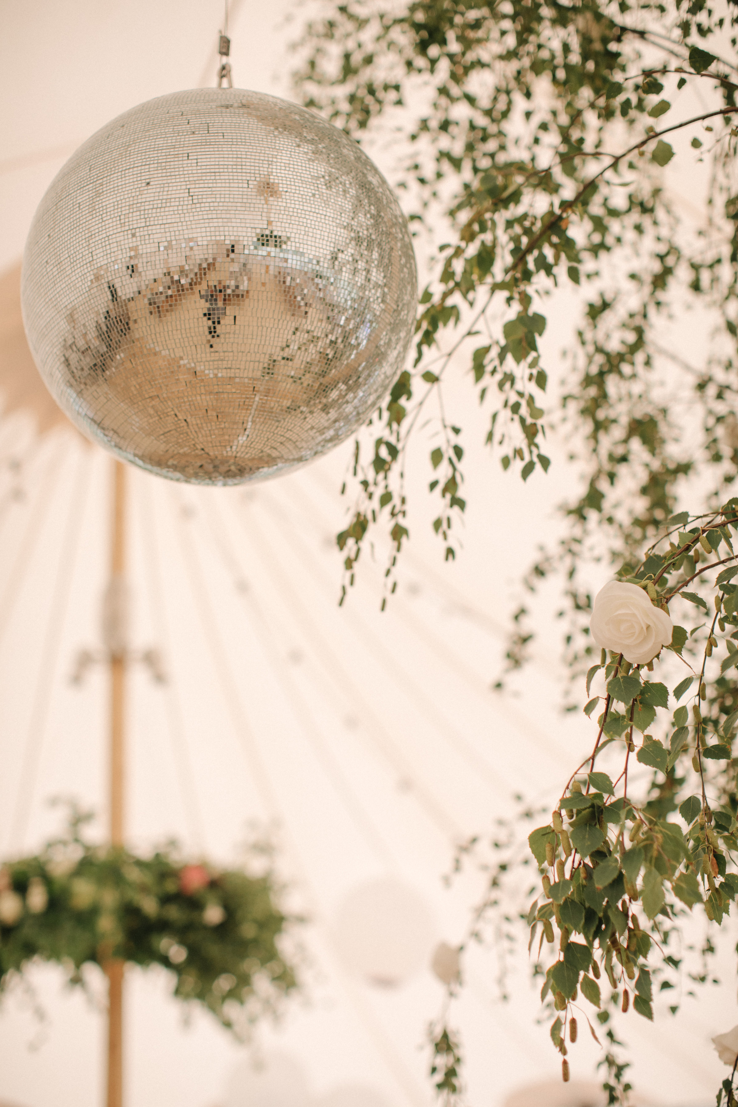 Steph & Ed's PapaKåta Sperry Tent wedding at home in Nottingham captured by M & J Photography: Sperry Tent Mirror Ball