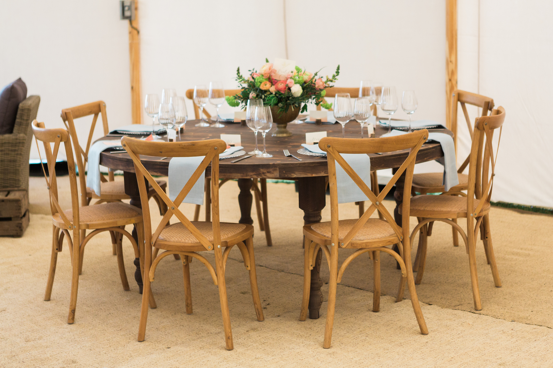 PapaKåta Spring Open Weekend Sperry Tent captured by Lucy Davenport Photography: Round Farmhouse Table with Cross Back Chairs