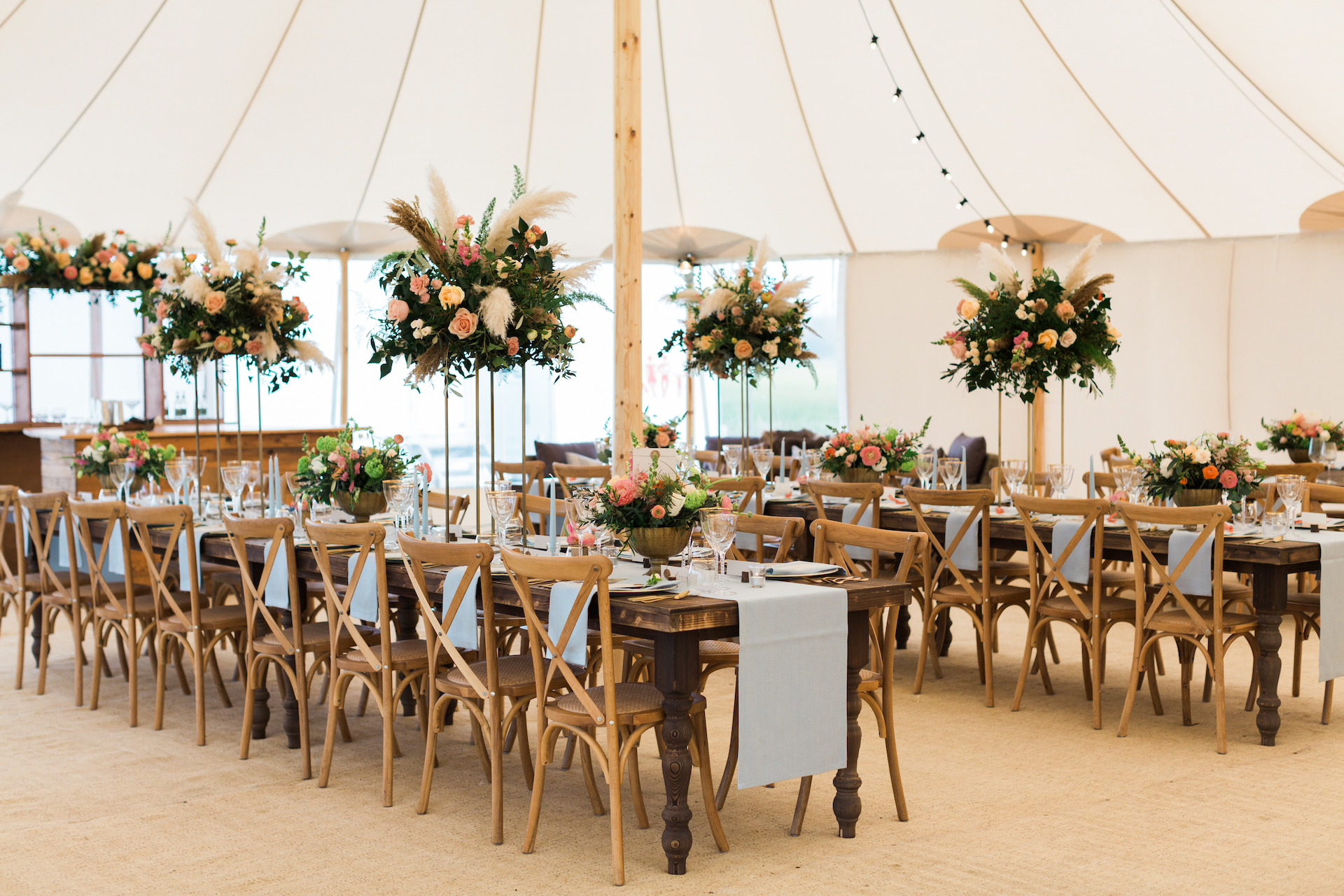 PapaKåta Spring Open Weekend Sperry Tent captured by Lucy Davenport Photography: Farmhouse Tables & Cross Back Chairs, Just 4 Linen, White House Event Crockery, Floral Centrepieces by Leafy Couture