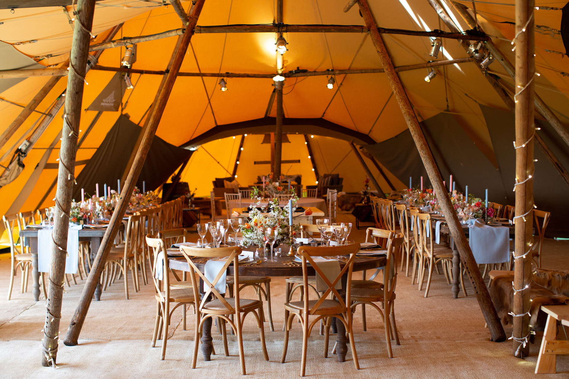 PapaKåta Spring Open Weekend Teepee captured by Lucy Davenport Photography: Round Farmhouse Tables & Cross Back Chairs