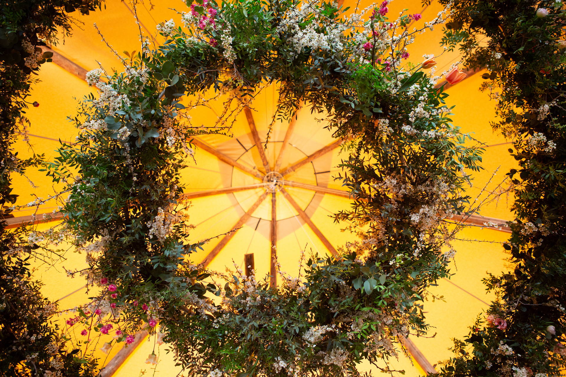 PapaKåta Spring Open Weekend Teepee captured by Lucy Davenport Photography: Two Tier Floral Hoop with flowers by Aelisabet Flowers