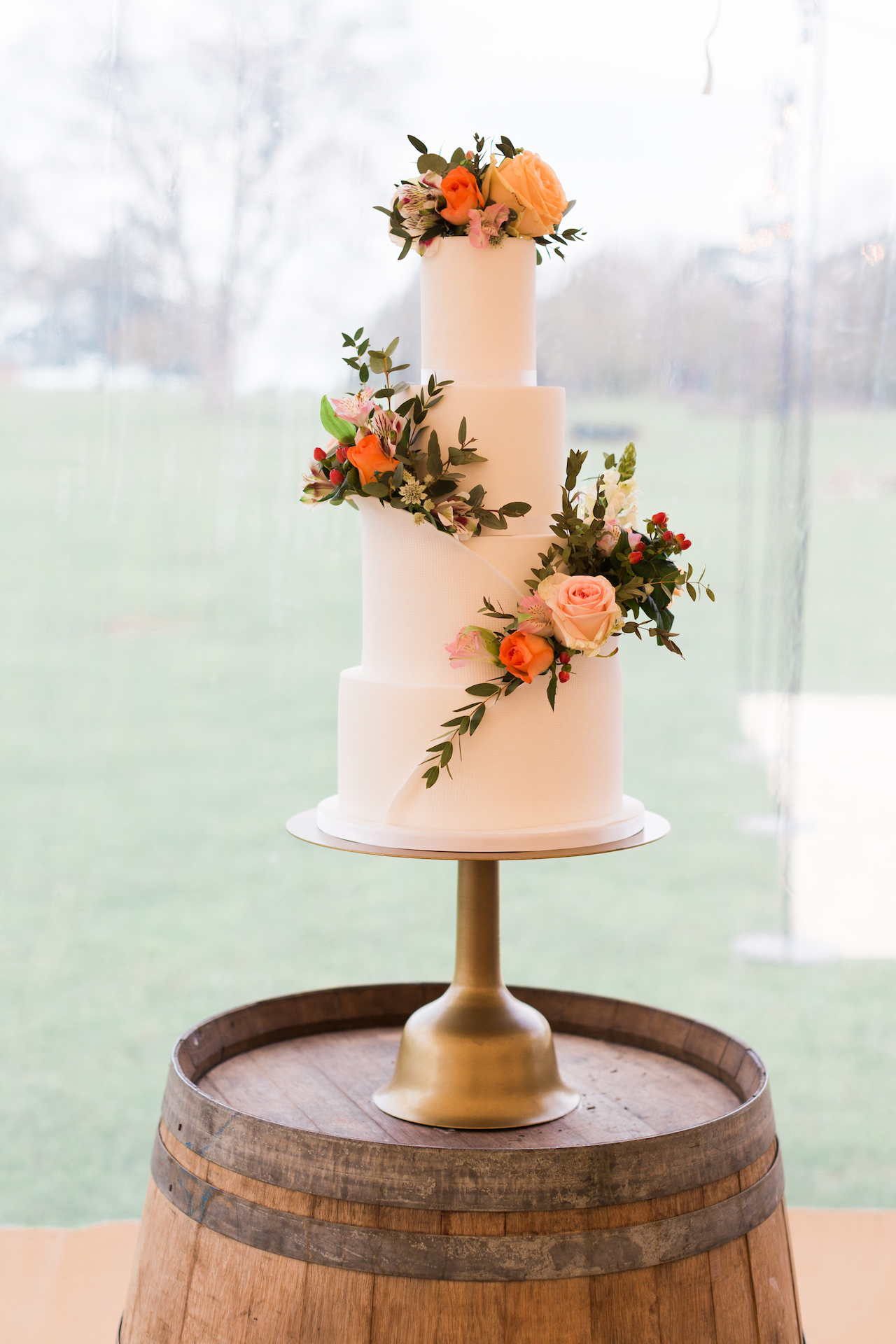 PapaKåta Spring Open Weekend Sperry Tent captured by Lucy Davenport Photography: Wine Barrel Cake Table with Wedding Cake by Cherry Blossom Bakes