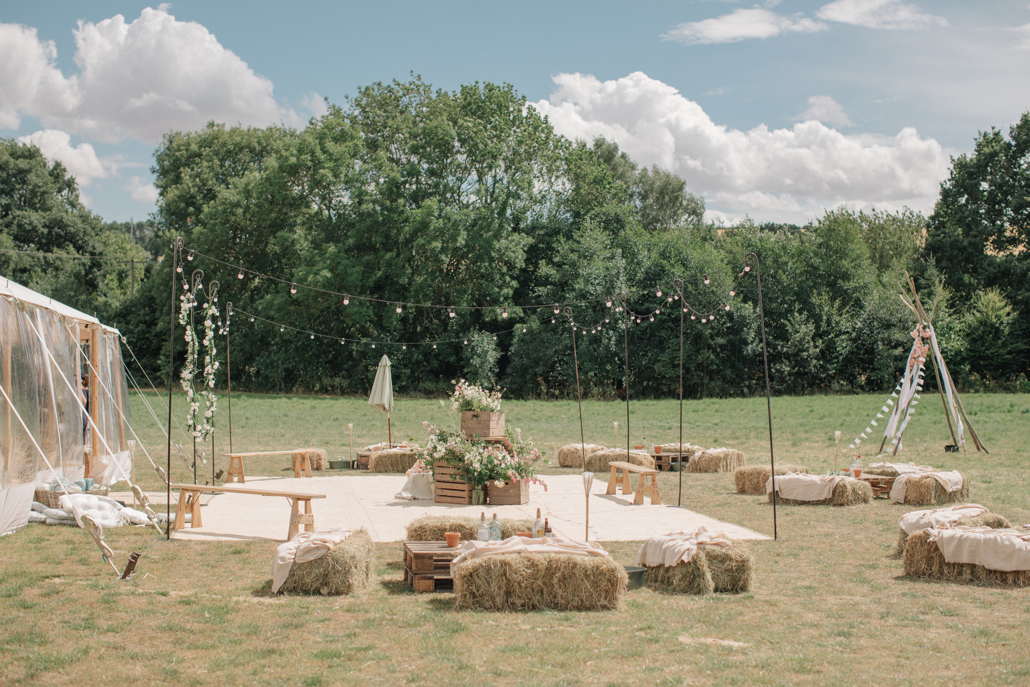 Steph & Ed's PapaKåta Sperry Tent wedding at home in Nottingham captured by M & J Photography: Festoon Terrace Outdoor Seating Area