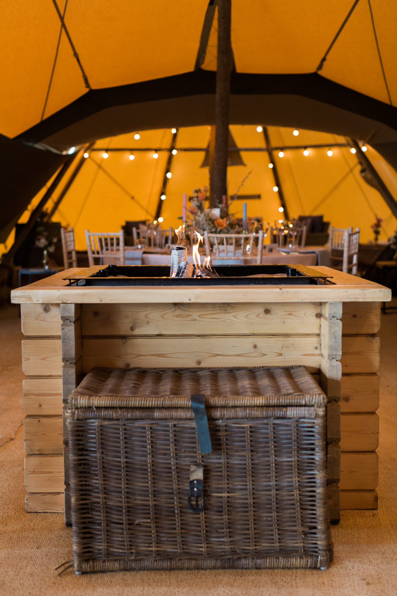 PapaKåta Spring Open Weekend Teepee captured by Lucy Davenport Photography: Teepee Open Fireplace and Log Basket